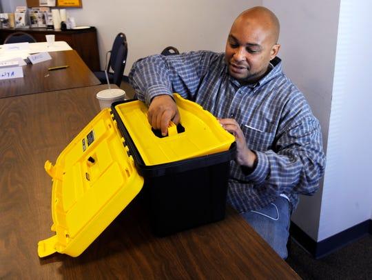 Corey Garrett gets a new tool box for his new job as