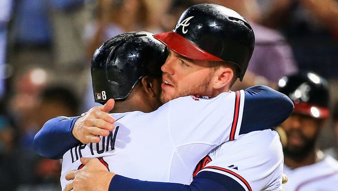 Sep 24, 2014; Atlanta, GA, USA; Atlanta Braves left fielder Justin Upton (8) celebrates with first baseman Freddie Freeman (5) after a home run in the fourth inning against the Pittsburgh Pirates at Turner Field. Mandatory Credit: Daniel Shirey-USA TODAY Sports