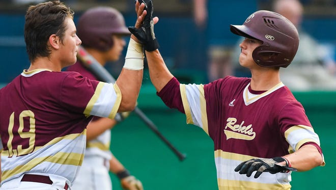 George County's Kyle Whiitington is congratulated by Logan Tanner.