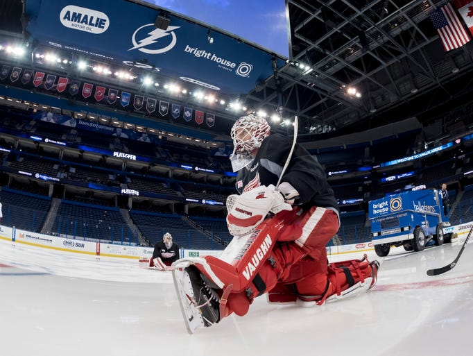 Detroit goalie Jimmy Howard stretches before the morning