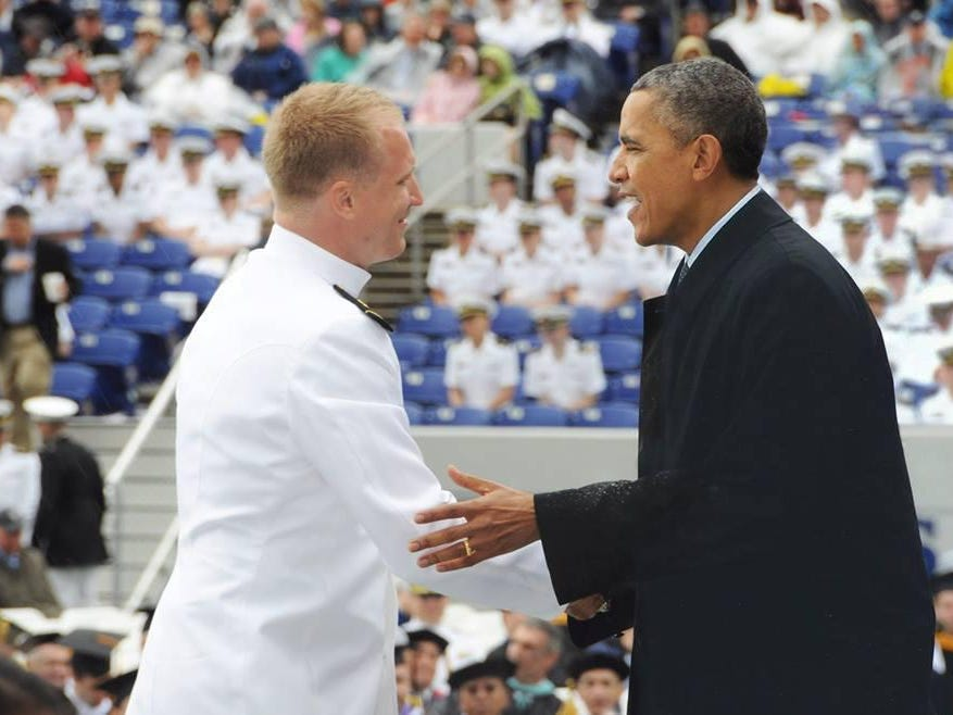 Josh Patton, left, receives his Naval Academy college degree from President Barack Obama.