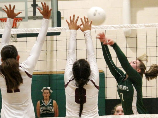 Cloudcroft's Meghan Edwards attempts to push a ball over Tularosa's Cyan Fossum (8) and Alex Veyna (11) on Thursday evening.