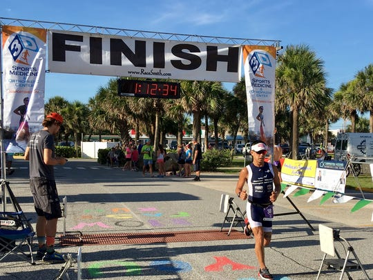 Jeff Salinas of Melbourne finishes Boardwalk Triathlon