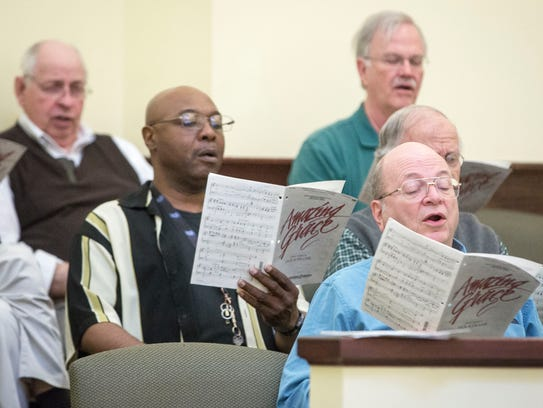 A community choir under the direction of retired Ball State choral director professor Doug Amman rehearses in advance of the Community Good Friday Service. Services will be at noon on March 30 at Union Missionary Baptist Church.