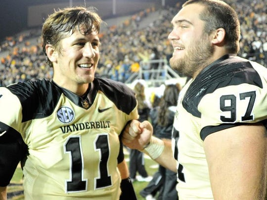 Vanderbilt quarterback Jordan Rodgers (11) and defensive tackle Jared Morse celebrate a 41-18 victory over Tennessee in 2012.
