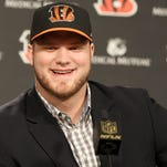 The selection of offensive linemen Cedric Ogbuehi and Jake Fisher in the first two rounds of the draft has team captain and left guard Andrew Whitworth wondering about his future with the Bengals.
