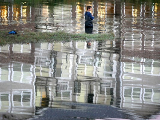 Parker Stephens,15, of Bremerton tires to hook a salmon while fishing next to the Old Sawmill Park in Silverdale on Wednesday. The reflection in the water is from Crista Shores. LARRY STEAGALL / KITSAP SUN