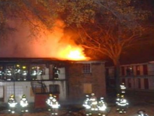 Memphis firefighters battle a blaze at Eastwood Park Apartments Tuesday night.