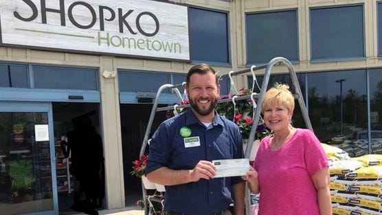 Sister Bay Shopko store manager, Mike Pride, recently presented the award to Altrusan Cheri Meyvis.