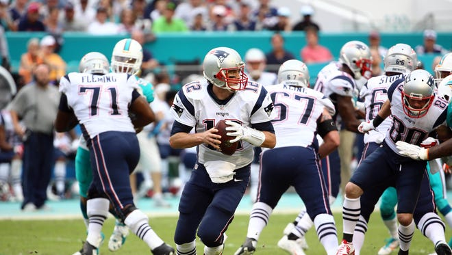 Jan 3, 2016: New England Patriots quarterback Tom Brady (12) scrambles against the Miami Dolphins during the second half at Sun Life Stadium. The Dolphins won 20-10.