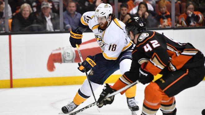 Nashville Predators right wing James Neal (18) tries to shoot past Anaheim Ducks defenseman Josh Manson (42) during the third period of game 1 of the Western Conference finals at the Honda Center in Anaheim, Calif., Friday, May 12, 2017.