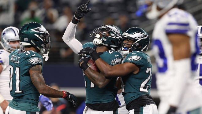 Philadelphia Eagles safety Malcolm Jenkins (27) celebrates his fourth quarter interception with Corey Graham (24) against the Dallas Cowboys at AT&T Stadium.