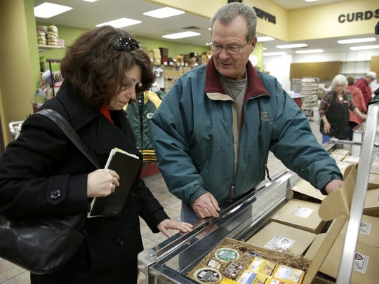 Marcia and Herb Ilk browse through the different gift boxes offered at Simon's Specialty Cheese in Little Chute.