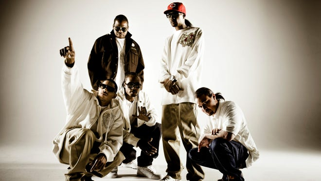 Bone Thugs-n-Harmony (l-to-r) Layzie Bone, Flesh-N-Bone, Bizzy Bone, standing Wish Bone, Krayzie Bone, in 2009.