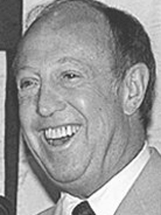 Text: file--nfl commissioner pete rozelle, shown speaking in phoenix in this 1988 file photo, died friday, dec. 6, 1996 at his home in rancho santa fe, calif. he was 70.(ap photo/rob schumacher).
