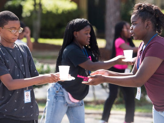Sixth-grade students take part in a fun relay at the Montgomery Police Department's 17th annual Junior Police Academy on Wednesday July 12, 2017 in Montgomery, Ala.
