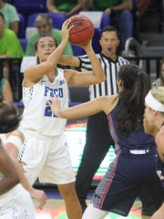 Sarah Coward/The News-Press FGCU?s Jaime Gluesing searches for an open player during the Eagles? home opener against FAU on Tuesday night at Alico Arena. FGCU was upset 62-55. FGCU's Jaime Gluesing searches for an open player during the home opener between FGCU and FAU in Fort Myers Tuesday.