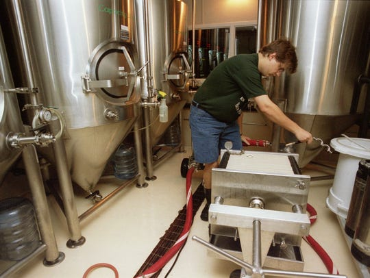 Chris Laumb worked with a brewing system in August