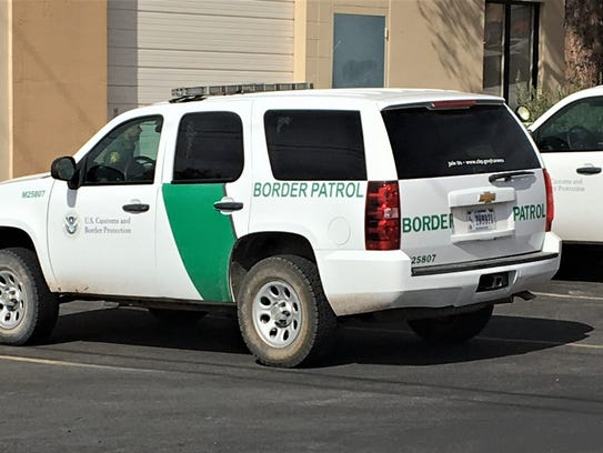 Border Patrol trucks parked during a search of a storm