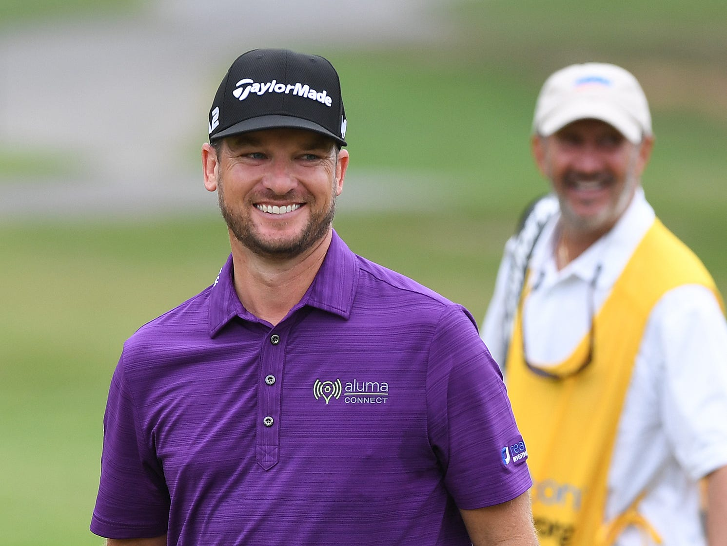 Kyle Thompson smiles as he plays at Furman during the first day of the BMW Charity Pro-Am on Thursday, May 18, 2017.