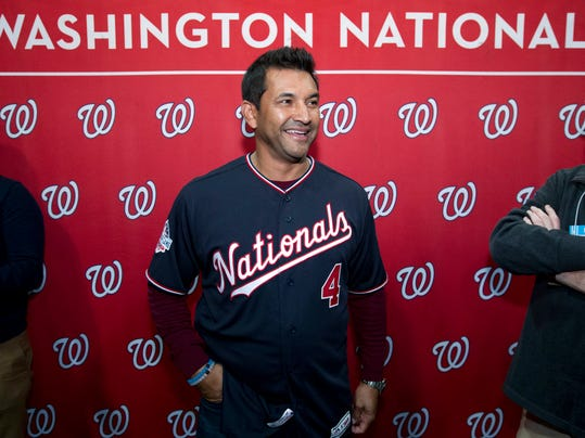 FILE - In this Dec. 16, 2017, file photo, Washington Nationals manager Dave Martinez speaks with the media during the baseball club's Winter Fest celebration with fans at Washington Convention Center in Washington. Tirst-time manager Dave Martinez takes over the team that has won two consecutive NL East titles but never won a playoff series.(AP Photo/Jose Luis Magana, File)