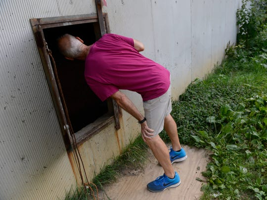 Gunther Stern, executive director of the Georgetown Ministry Center, checks in an enclosed area under a highway overpass  for individuals living on the street in Washington.