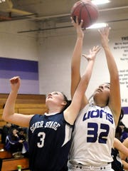 Yerington's Alexceah Emm comes up with a rebound against Silver Springs' Rebecca Bowman.