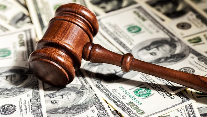 """The Arizona Attorney General's Office has settled a lawsuit over notices sent to businesses that asked them to pay $125 for """"annual minutes"""" reports."""