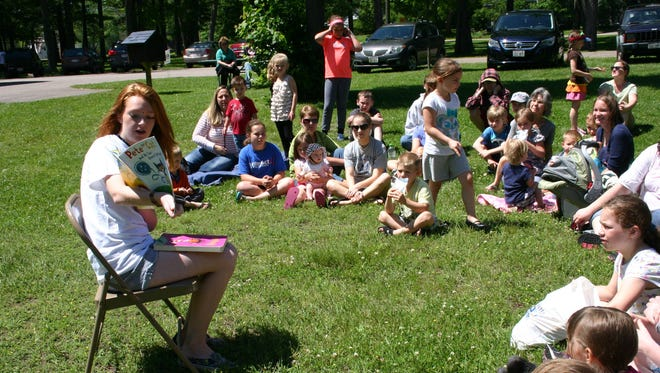 Celeste Huff, a senior at Lincoln High School, is shown reading books to children at the Wisconsin Rapids Municipal Zoo on June 12. At this event, 58 children (and 81 people total including adults) attended.