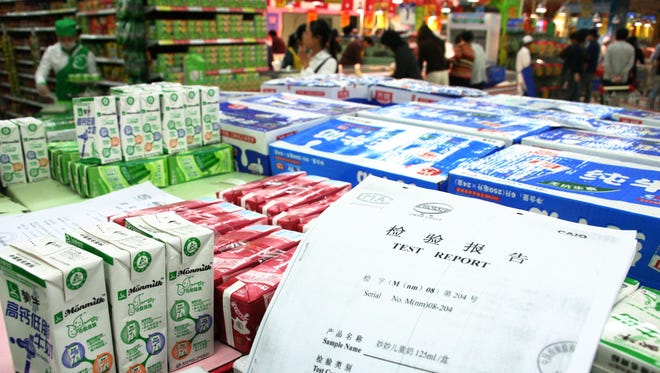 Copies of test reports to verify that milk products are free of melamine sit available to customers at a supermarket on Sept. 30, 2008, in Nanjing, China. The run on Dutch milk products dates to 2008, when the Chinese government disclosed that one of the country's biggest dairy producers had been watering down formula and adding melamine -- an industrial compound used in manufacturing plastics and adhesives.