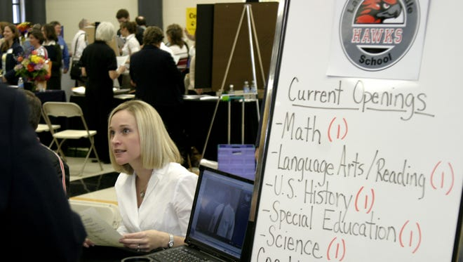 La Vergne Middle School Assistant Principal Julie Walker offers job details to hopeful applicants at a Rutherford County Schools recruitment fair in 2007.