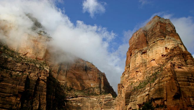 Angels Landing towers nearly 1,500 feet above Zion Canyon in Zion National Park. Visitors can hike 2.7 miles to the top on one of the park's most popular and infamous hikes.Brian Passey / The Spectrum & Daily News