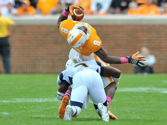 Chattanooga defender Dee Virgin (3) brings down Tennessee