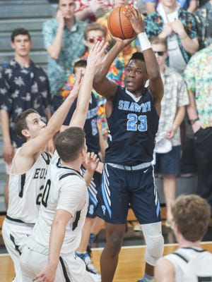 Shawnee forward Daevon Robinson shoots over the outstretched arms of Bishop Eustace's Peyton Vostenak and Alec DiPietrantonio during Monday's game.