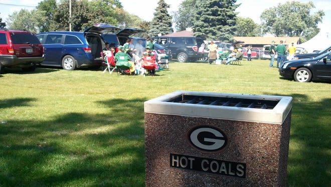 Green Bay Packers fans tailgate in the new Lot 10 south of Lambeau Field on Sunday, Sept. 14, 2014.