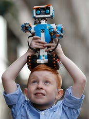 "Tristan Robertson-Jeyes, 6, plays with Vernie, a ""Lego"
