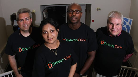 DeliveryCircle sales lead Scott Soucy, CEO and founder Vijaya Rao, independent delivery driver Levonne Mathis and Bill Haymond, director of sales at Delmarva Transportation.  ANDRE L. SMITH/THE NEWS JOURNAL DeliveryCircle sales lead Scott Soucy, CEO & Founder Vijaya Rao, independent delivery driver Levonne Mathis and Bill Haymond, director of sales at Delmarva Transportation at 12 Penns Way in New Castle.