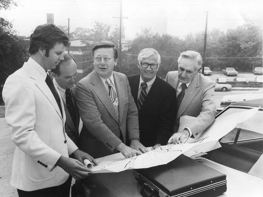Holding a pre-construction conference at the site of the $32.7 million City County Building are Project Director George Barrie, Fred Blatchford of Hyman Construction Co. of Atlanta, County Judge C. Howard Bozeman and architects Bruce McCarty and Carl Maples on Aug. 30, 1975. (News Sentinel Archive)