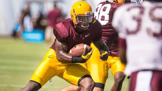 Arizona State's running back Kalen Ballage runs through a play during practice on Wednesday, Aug. 6, 2014, at the Bill Kajikawa Football Practice Field in Tempe.