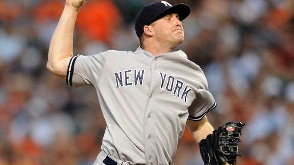 Yankees rookie Chase Whitley delivers in the first inning Sunday night in Baltimore.