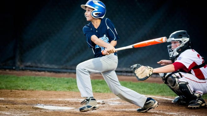 South Burlington Little League's Ben Mazza-Bergeron hits his first home run in Thursday's New England regional tournament game against New Hampshire.