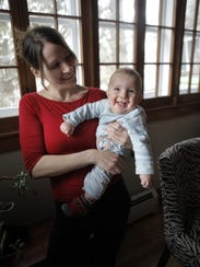 Hannah Dube plays with her son Wren Schebaum at home