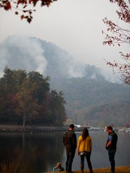 People stopped at the edge of Lake Lure to view the