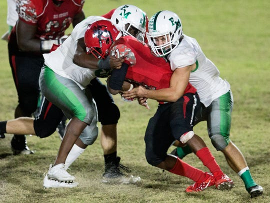 Fort Myers High School defenders tackle North Fort