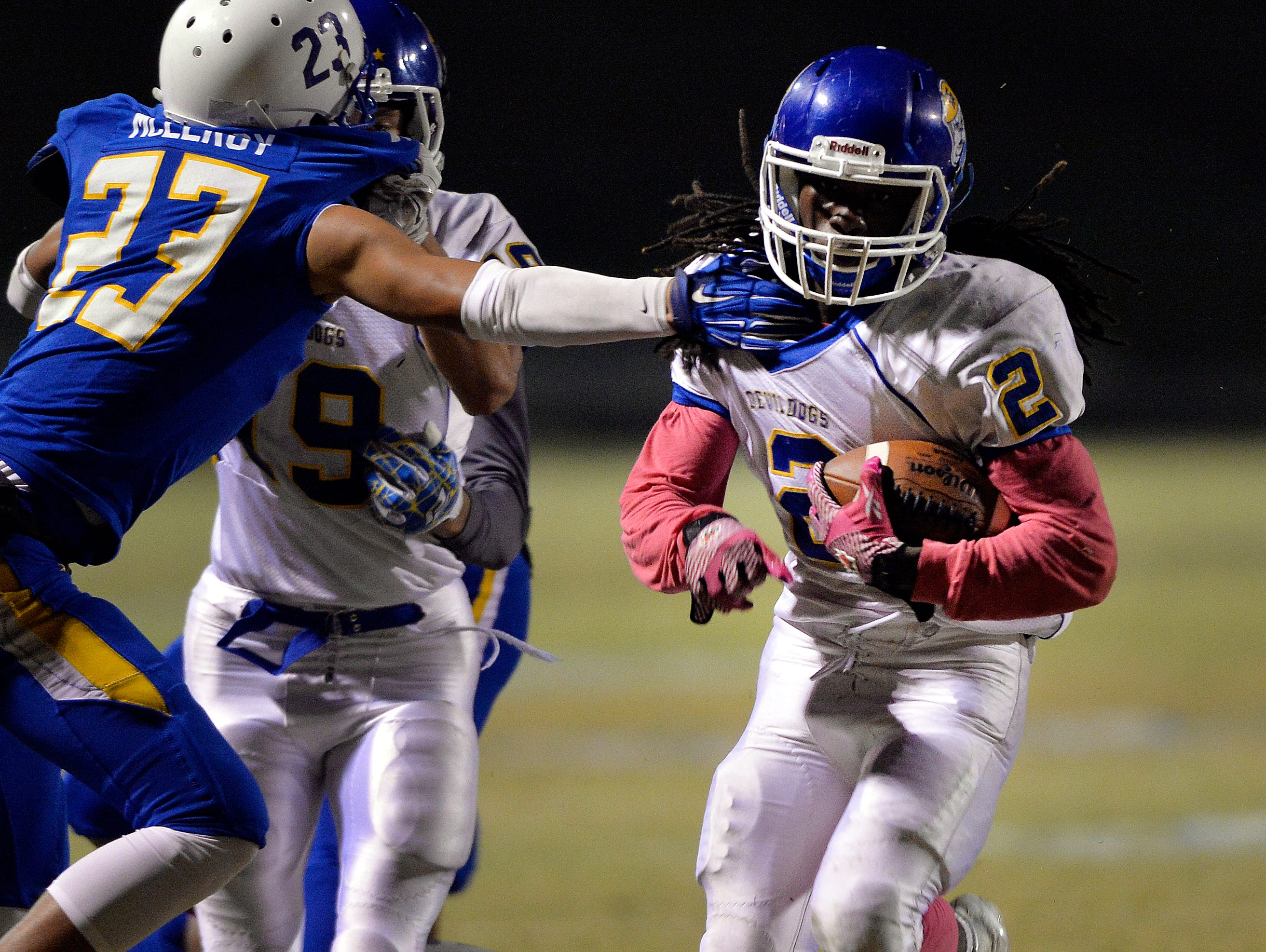 Travelers Rest's Xavier Terry (2) slips a Eastside's Nate McElroy (23) tackle on Oct. 23, 2015.