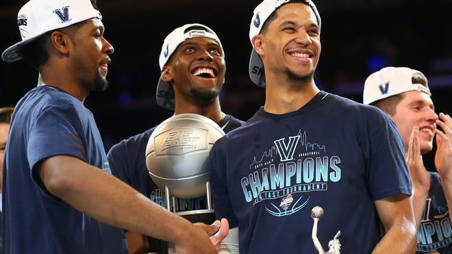 Josh Hart #3, Kris Jenkins #2 and Darryl Reynolds #45 of the Villanova Wildcats celebrate after defeating the Creighton Bluejays to win the Big East Basketball Tournament - Championship Game at Madison Square Garden on March 11, 2017 in New York City.