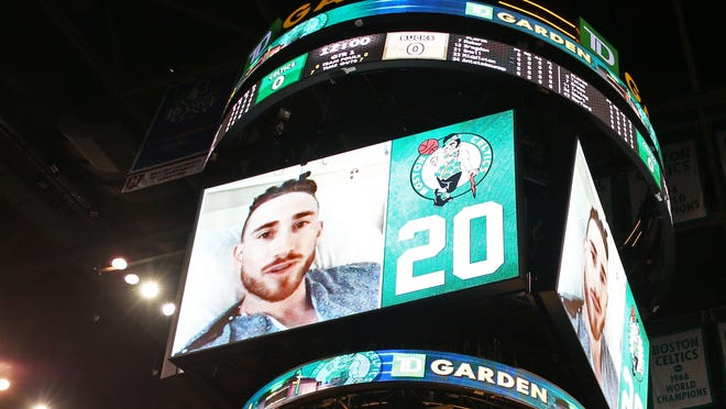 Gordon Hayward #20 of the Boston Celtics sends a message to fans through a recorded video before the game against the Milwaukee Bucks at TD Garden on October 18, 2017 in Boston, Massachusetts. Hayward did not attend the game after breaking his ankle the night before in the season opening game against the Cleveland Cavaliers. NOTE TO USER: User expressly acknowledges and agrees that, by downloading and or using this Photograph, user is consenting to the terms and conditions of the Getty Images License Agreement.