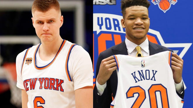 New York Knicks first round NBA Draft pick, Kevin Knox, poses with his jersey at the teams training facility Friday, June 22, 2018, in Tarrytown, N.Y.  (AP Photo/Kevin Hagen) ORG XMIT: NYKH103