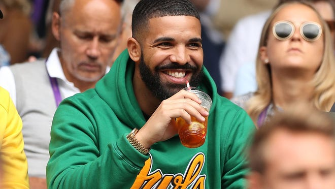 Rapper Drake sits on Centre Court before US player Serena Williams plays against Italy's Camila Giorgi during their women's singles quarter-final match on the eighth day of the 2018 Wimbledon Championships at The All England Lawn Tennis Club in Wimbledon, southwest London, on July 10, 2018.