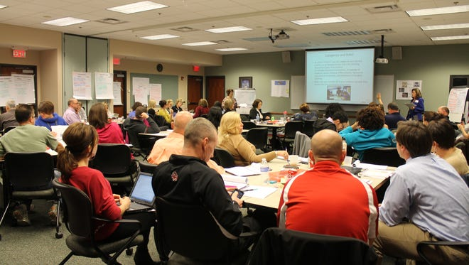 Administrators and teachers from several school districts complete teacher evaluation system training to become credentialed by the Ohio Department of Education.